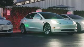 Stay Charged at a public charging station on the road - Tesla