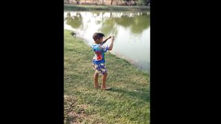 Boy Catches Fish...With A Toy Fishing Pole
